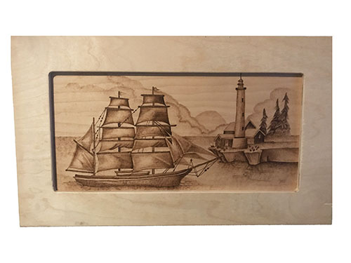 Item of the Month: Sailboat Lighthouse Pyrography